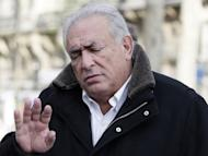 Former International Monetary Fund chief Dominique Strauss-Kahn gestures as he leaves a restaurant on December 11, 2012 in Paris. Strauss-Kahn is taking legal steps to stop a controversial new book by Argentinian-born Marcela Iacub detailing their liaison, his lawyers said on Monday