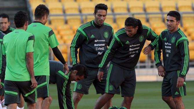 Mexico's Aguilar, Montes, De Nigris, Pena and Zinha joke around during a training session for their World Cup qualifying playoff second leg soccer match against New Zealand in Wellington