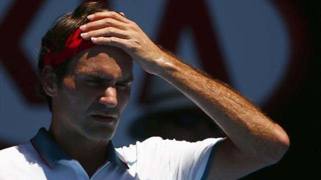 Australian Open - Federer eases though opener in Melbourne