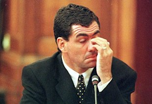 Sacked South African cricket captain Hansie Cronje wipes his eye during his cross-examination at the King Commission of Inquiry into allegations of cricket match-fixing (23 June 2000). Cronje later broke down and left the hearings in tears at the conclusion of his testimony.
