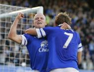 Everton's Steven Naismith (L) celebrates with team mate Nikica Jelavic after scoring a goal against Chelsea during their English Premier League soccer match at Goodison Park in Liverpool, northern England September 14, 2013. REUTERS/Phil Noble