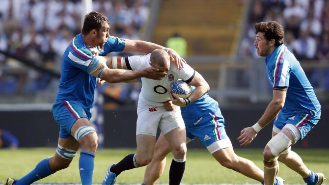 England's Mike Brown is tackled by Italy's Quintin Geldenhuys during their Six Nations rugby union match at Olympic Stadium in Rome