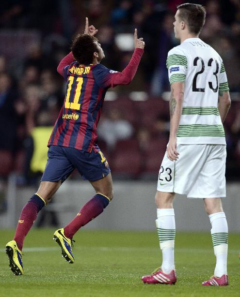 FC Barcelona's Neymar, from Brazil, reacts after scoring against Celtic during a Champions League soccer match group H at the Camp Nou in Barcelona, Spain, Wednesday, Dec. 11, 2013