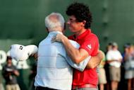 Rory McIlroy of Northern Ireland hugs his father Gerry McIlroy after winning the 94th PGA Championship at the Ocean Course, on August 12, in Kiawah Island, South Carolina. The 23-year-old Northern Irishman surpassed Luke Donald to become the No. 1 ranked player in the world as he closed with a six-under 66 in the final major championship of the season
