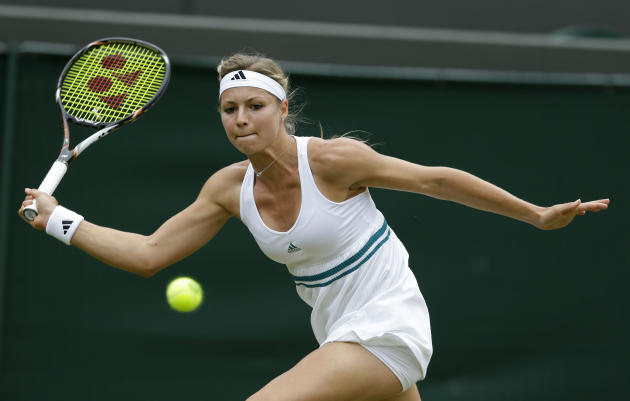 Maria Kirilenko of Russia plays a return to Agnieszka Radwanska of Poland during a quarterfinals match at the All England Lawn Tennis Championships at Wimbledon, England, Tuesday, July 3, 2012. (AP Ph