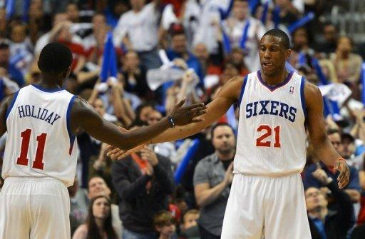 Philadelphia 76ers' Jrue Holiday and Thaddeus Young celebrate after their team wins 89-82 against the Bulls