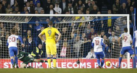 Brighton's Tomer Hemed scores their second goal from the penalty spot