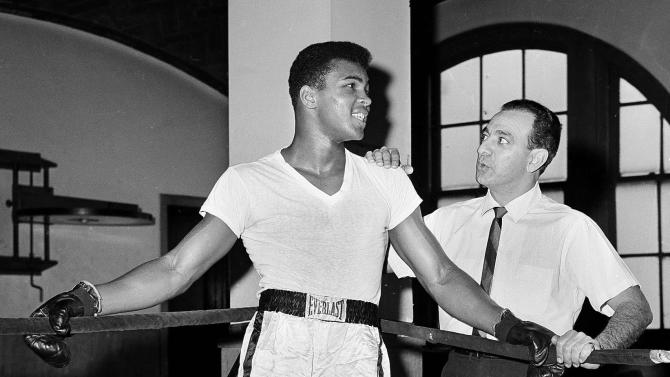 FILE - In this Feb. 8, 1962, file photo, young heavyweight fighter Cassius Clay, who later changed his name to Muhammad Ali,  is seen with his trainer Angelo Dundee at City Parks Gym in New York. Ali turns 70 on Jan. 17, 2012. (AP Photo/Dan Grossi, File)