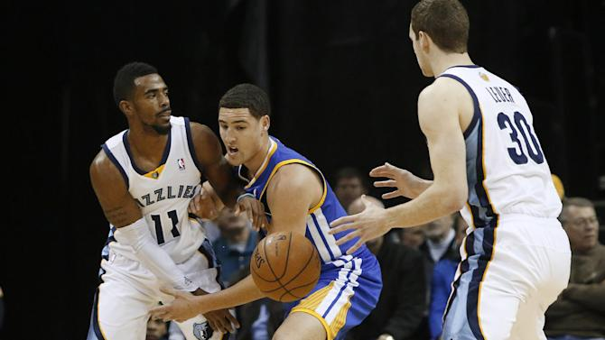 Memphis Grizzlies guard Mike Conley (11) gets a pass to forward Jon Leuer (30) under pressure from Golden State guard Klay Thompson, center, in the first half of an NBA basketball game Saturday, Dec. 7, 2013, in Memphis, Tenn
