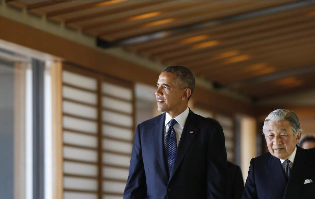 U.S. President Obama looks at outside as he walks with Japan's Emperor Akihito in the Imperial Palace in Tokyo