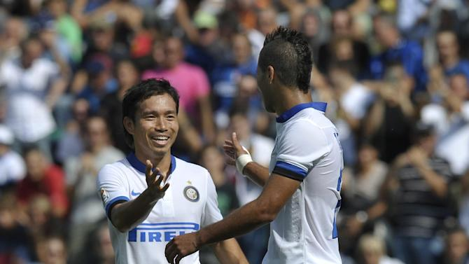 Inter Milan's Saphir Taider of Algeria, right, celebrates with his teammate Juto Nagatomo, of Japan, after scoring a goal during their Serie A soccer match against Sassuolo, at Reggio Emilia's Mapei stadium, Italy, Sunday, Sept. 22, 2013