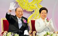 "File photo of Sun Myung Moon (L), the founder of the Unification Church, and his wife Han Hak-Ja (R) blessing newlyweds during a mass wedding ceremony in South Korea. The illness of Sun Myung Moon is ""irreversible"", the church said Friday, after he was hospitalised with complications from pneumonia"