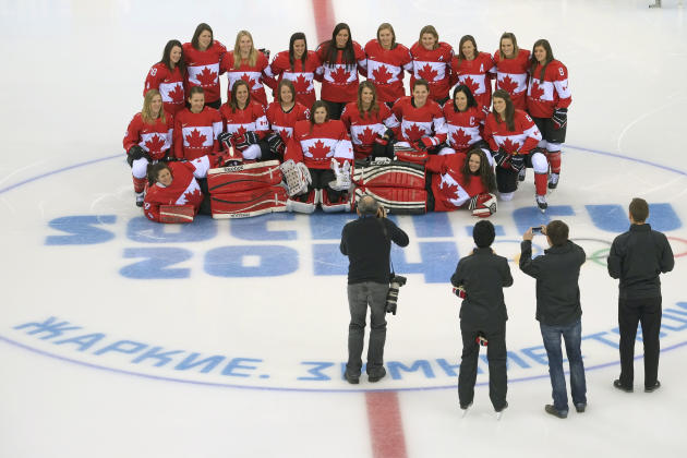 Members of the Canadian women's ice hockey team pose for a team photo during practice ahead of the 2014 Winter Olympics, Thursday, Feb. 6, 2014, in Sochi, Russia. (AP Photo/J. David Ake)