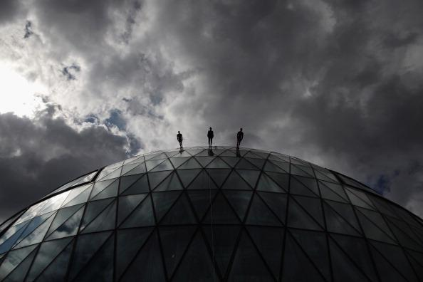 Dancers walk down City Hall as part of the 'One Extraordinary Day' performances on July 15, 2012 in London, England. The dancers are part of American choreographer Elizabeth Streb's 'extreem action' d