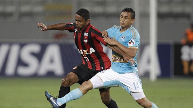 Deivid of Brazil's Atletico Paranaense, left, fights for the ball with Yoshimar Yotun of Peru's Sporting Cristal during a Copa Libertadores soccer match in Lima, Peru, Wednesday, Jan. 29, 2014