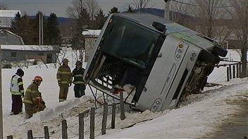 Emergency personnel work at the scene of a fatal bus crash near Plessisville, Que. on March 3, 2012.