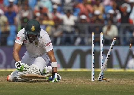 South Africa's Faf du Plessis sits after he was bowled out by India's Amit Mishra during the third day of their third test cricket match in Nagpur