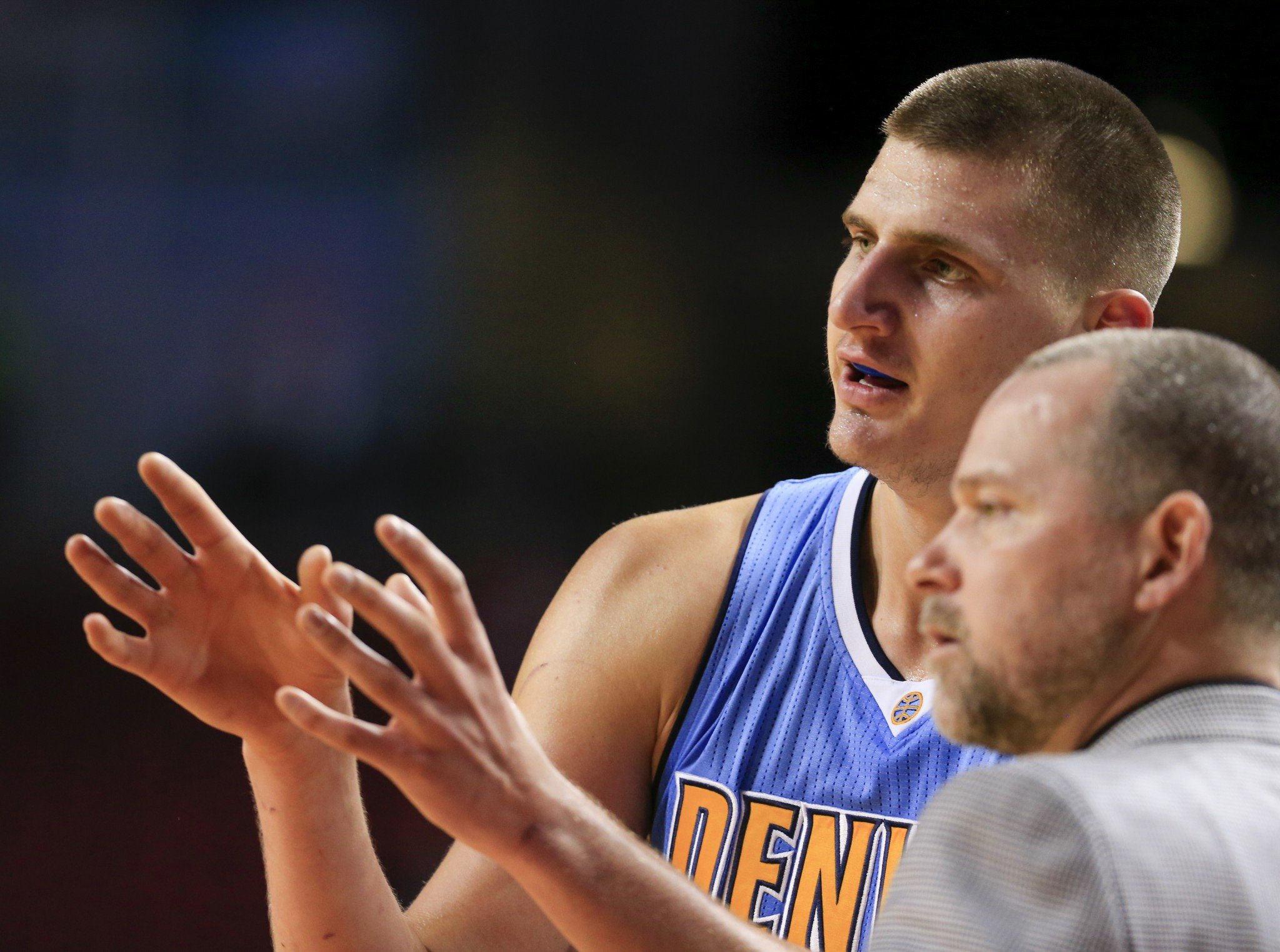 Nikola Jokic describes how he sees the celebration going. Mike Malone is not so sure. (AP)