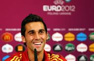 "In this handout image provided by UEFA, Spanish defender Alvaro Arbeloa takes part in a press conference in Donetsk. Arbeloa says he is psyching himself up ""mentally and physically"" to face Real Madrid team-mate Cristiano Ronaldo in the Euro 2012 semi-final against Portugal on Wednesday"
