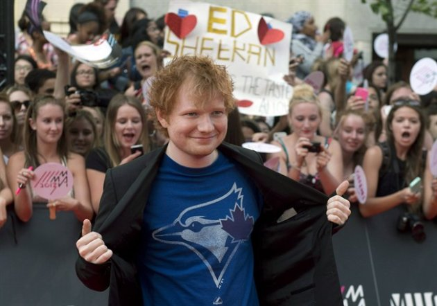 Ed Sheeran poses on the red carpet during the 2013 Much Music Video Awards in Toronto on Sunday June 16, 2013. THE CANADIAN PRESS/Chris Young