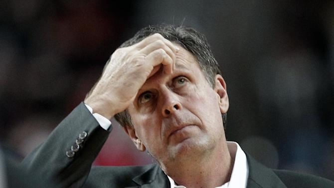 Houston Rockets coach Kevin McHale takes a time out during the first half of an NBA basketball game against the Portland Trail Blazers in Portland, Ore., Tuesday, Nov. 5, 2013