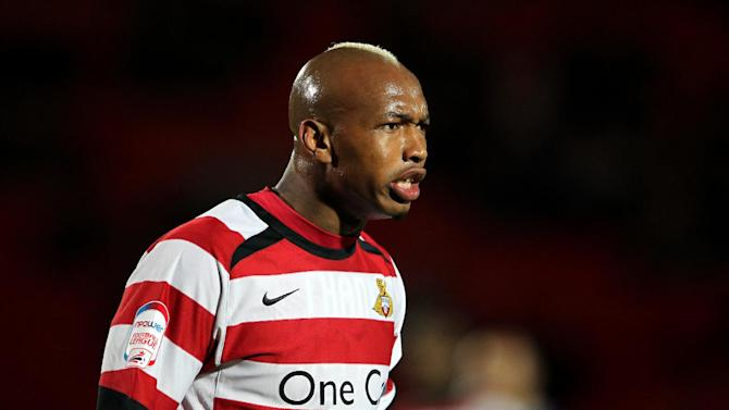 El-Hadji Diouf, pictured, has managed to change Neil Warnock's opinion of him