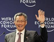Singaporean Prime Minister Lee Hsien-Loong is seen at the World Economic Forum (WEF) on East Asia in Jakarta in 2011. Singapore is to slash its leaders' unpopular multi-million-dollar salaries by at least a third, but they will remain the world's best-paid politicians