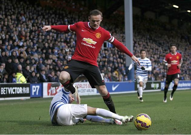 Manchester United striker Wayne Rooney (top) vies for the ball with Queens Park Rangers' defender Mauricio Isla during their Premier League match at Loftus Road Stadium in London, on January 17, 2