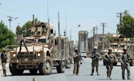 US soldiers stop traffic after a terror attack in Kandahar in April 2012. A suicide car bomb attack outside a university in southern Afghanistan on Monday killed at least seven civilians and wounded more than 20, officials said