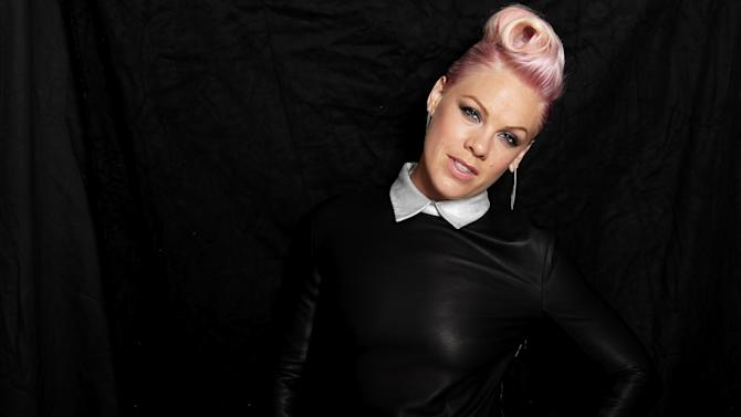 "In this Aug. 6, 2012 photo, singer-songwriter Pink poses for a portrait in Santa Monica, Calif. Now that she has tackled marriage and motherhood, Pink expects her next challenge will be outdoing herself, not other artists, on stage when she goes on tour in support of her new album, ""The Truth About Love,"" releasing on Sept. 18, 2012. (Photo by Matt Sayles/Invision/AP)"