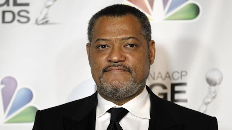 FILE - In this Feb. 17, 2012 file photo, Laurence Fishburne poses backstage at the 43rd NAACP Image Awards in Los Angeles.  A Los Angeles judge on Wednesday Jan. 23, 2013 refused to grant Fishburne a three-year restraining order against a  convicted felon who has tried to evict him from his house. (AP Photo/Matt Sayles, File)