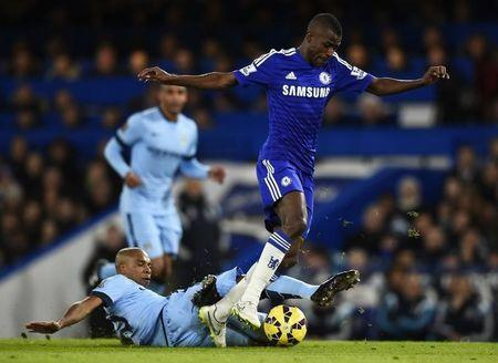 Chelsea's Ramires is challenged by Manchester City's Fernandinho during their English Premier League soccer match at Stamford Bridge in London