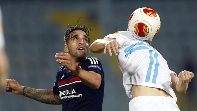 Olympique Lyon's Miguel Lopes, left, is challenged by Rijeka's Mehmed Alispahic during their group I Europa League soccer match, at Kantrida stadium in Rijeka, Croatia, Thursday, Nov. 7, 2013