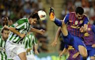 Barcelona's Sergio Busquets (R) fights for the ball with Real Betis' Javier Chica during their Spanish La Liga match at Benito Villamarin stadium in Sevilla. Ten-man Barcelona needed an injury-time goal to secure a 2-2 draw