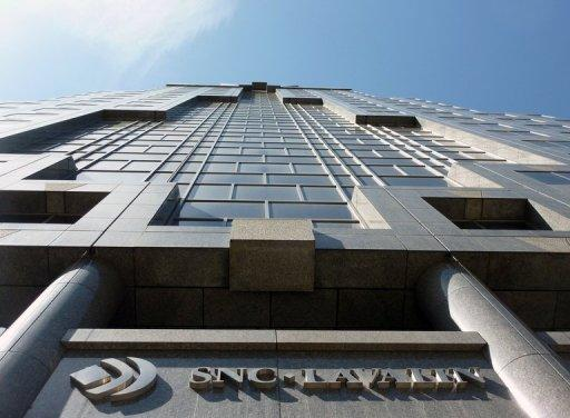 SNC-Lavalin's headquarters in Montreal, Quebec. Swiss authorities have charged a former SNC-Lavalin executive with money laundering over mysterious payments by the Canadian engineering firm, Canada's and Switzerland's public broadcasters said Sunday.