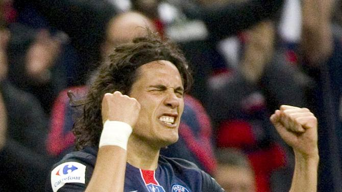 Paris St Germain's Edinson Roberto Cavani reacts after scoring a goal for his team against Auxerre in their French Cup final soccer match at the Stade de France stadium in Saint-Denis