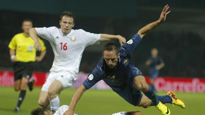 France's Franck Ribery, right, challenges for the ball with Belarus' Aleksandr Martynovich during their World Cup Group I, qualifying soccer match in Gomel, Belarus, Tuesday, Sept. 10, 2013