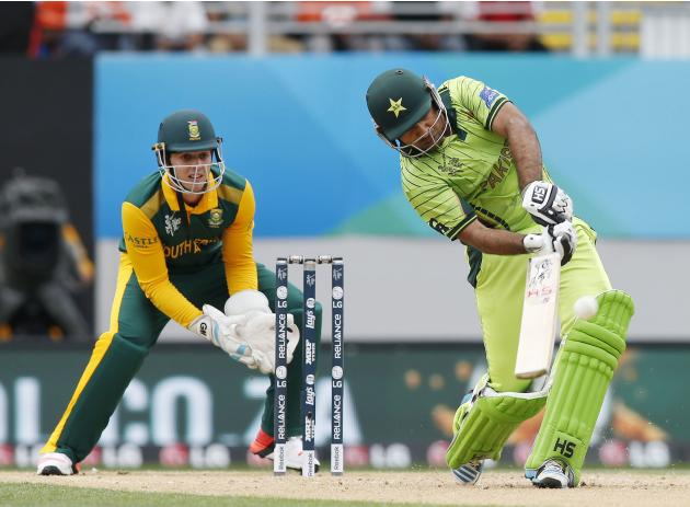 Pakistan's Ahmed hits a four watched by South Africa's De Kock during their Cricket World Cup match in Auckland
