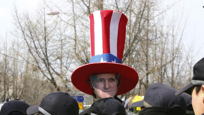 A South Korean man, wearing a mask of U.S. Secretary of State John Kerry, protests against the ongoing military exercises and demanding Kerry to go to North Korea for peace talks near the presidential house in Seoul, South Korea, Friday, April 12, 2013.  Kerry arrived in South Korea on Friday on an unusual diplomatic journey, traveling directly into a region bracing for a possible North Korean missile test and risking that his presence alone could spur Pyongyang into another headline-seeking provocation. (AP Photo/Ahn Young-joon)
