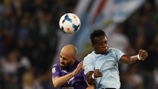 Fiorentina midfielder Borja Valero, of Spain, left, and Lazio midfielder Ogenyi Onazi, of Nigeria, jump for the ball during a Serie A soccer match between Lazio and Fiorentina, at Rome's Olympic stadium, Sunday, Oct. 6, 2013