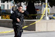 A police officer patrols the scene near the Canada War Memorial following a shooting incident in Ottawa October 22, 2014. REUTERS/Chris Wattie