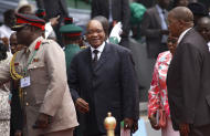 South Africa President Jacob Zuma, center, arrives for the inauguration ceremony of Nigeria President Goodluck Jonathan at the main parade ground in Nigeria's capital of Abuja, Sunday, May 29, 2011. Jonathan was sworn in Sunday for a full four-year term as president of Nigeria and is now faced with the challenge of uniting a country that saw deadly postelection violence despite what observers called the fairest vote in over a decade.