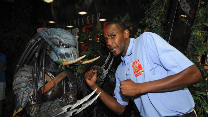 Kenneth King poses with a character from the Predator 3D movie during the Preview Night event on Day 1 of the 2013 Comic-Con International Convention on Wednesday, July 17, 2013 in San Diego. (Photo by Denis Poroy/Invision/AP)