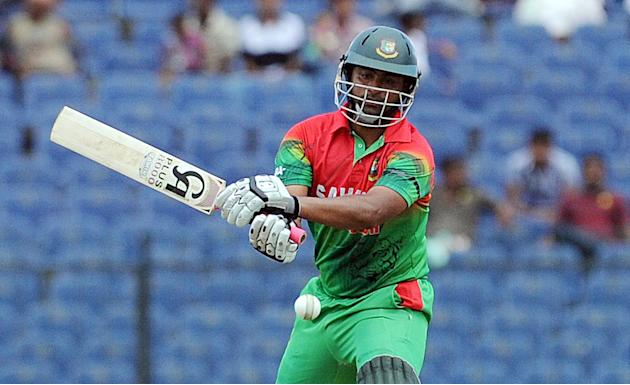 Bangladeshi batsmen Tamim Iqbal plays a shot during the opening one-day international (ODI) match between Sri Lanka and Bangladesh at The Suriyawewa Mahinda Rajapakse International Cricket Stadium in