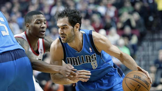 Dallas Mavericks guard Jose Calderon, right, from Spain, drives on Portland Trail Blazers guard Damian Lillard during the first half of an NBA basketball game in Portland, Ore., Saturday, Dec. 7, 2013
