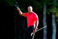 Tiger Woods made golf history, finishing third in the Deutsche Bank Championship Monday to become the first golfer to make more than $100 million in earnings on the PGA Tour