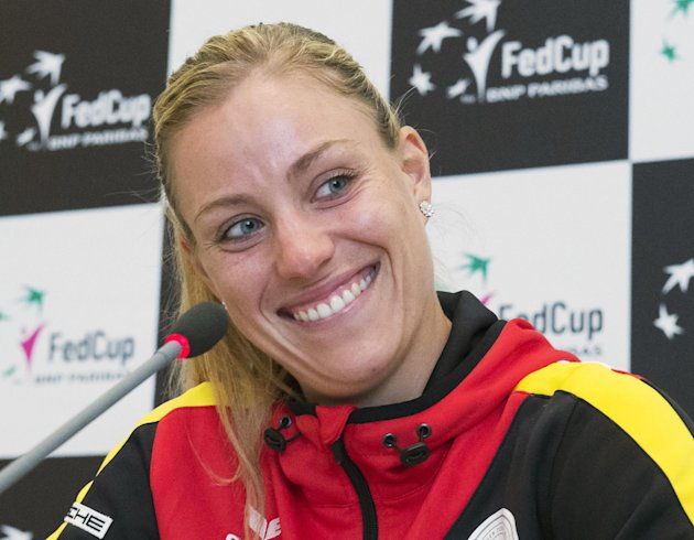 Australian Open 2016 winner and German Fed Cup tennis player Angelique Kerber smiles during a media conference at the Leipzig Fair in Leipzig, Germany, Wednesday, Feb. 3, 2016. Germany faces Switzerland in the World Group first round match on the upcoming weekend. (AP Photo/Jens Meyer)