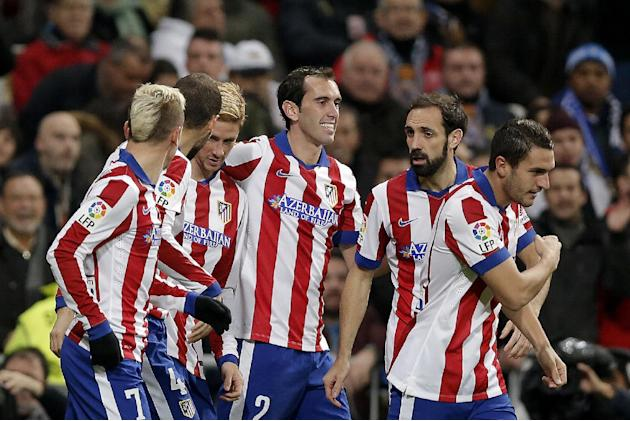Atletico de Madrid Fernando Torres, second left, celebrates after scoring a goal during a King's Cup soccer match between Atletico de Madrid and Real Madrid at the Santiago Bernabeu stadium in Madrid,