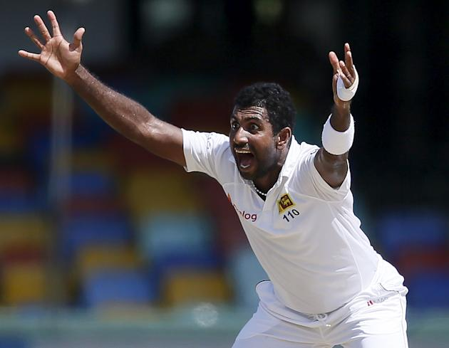 Sri Lanka's Prasad appeals for an unsuccessful wicket for India's Sharma during the fourth day of their third and final test cricket match in Colombo