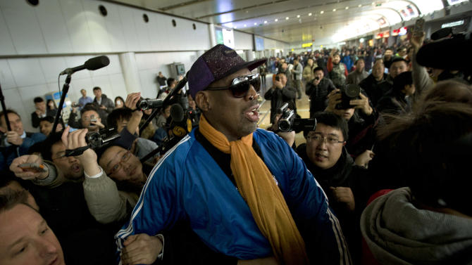 Former NBA basketball player Dennis Rodman is followed by journalists as he arrives at the Capital International Airport in Beijing from Pyongyang, Monday, Jan. 13, 2014. Rodman has checked into an undisclosed alcohol rehabilitation center to treat his long-time struggle with alcoholism, his agent says. (AP Photo/Alexander F. Yuan)